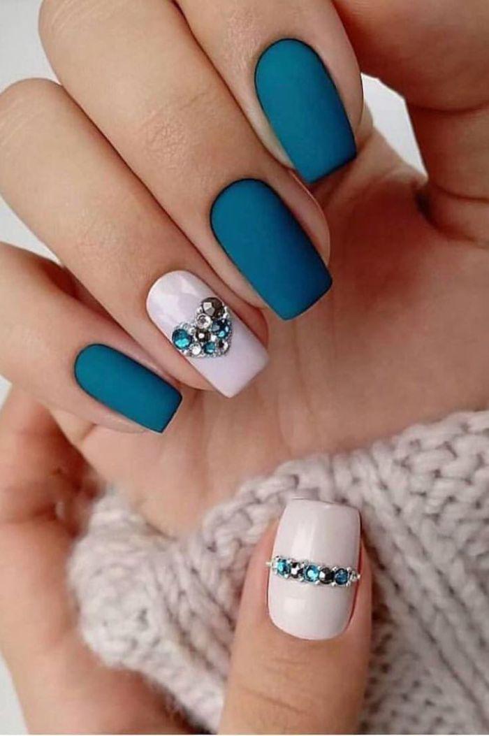matte finish on blue nail polish summer nails 2021 rhinestones forming heart on ring finger thumb