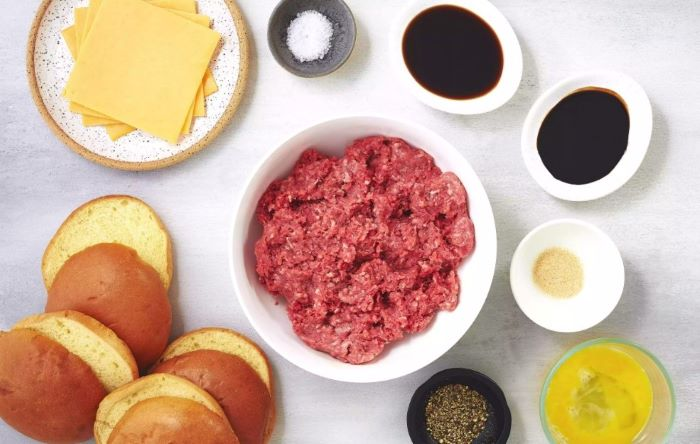 mince meat in bowl homemade burgers ingredients in bowls cheese buns on the side