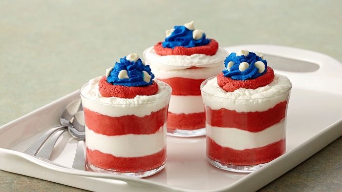 mini trifles with raspberry cream and cream cheese 4th of july food ideas decorated with blue cream on top