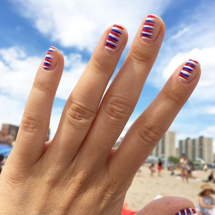 minimalistic design fourth of july nail designs red white blue stripes on one side of the nails