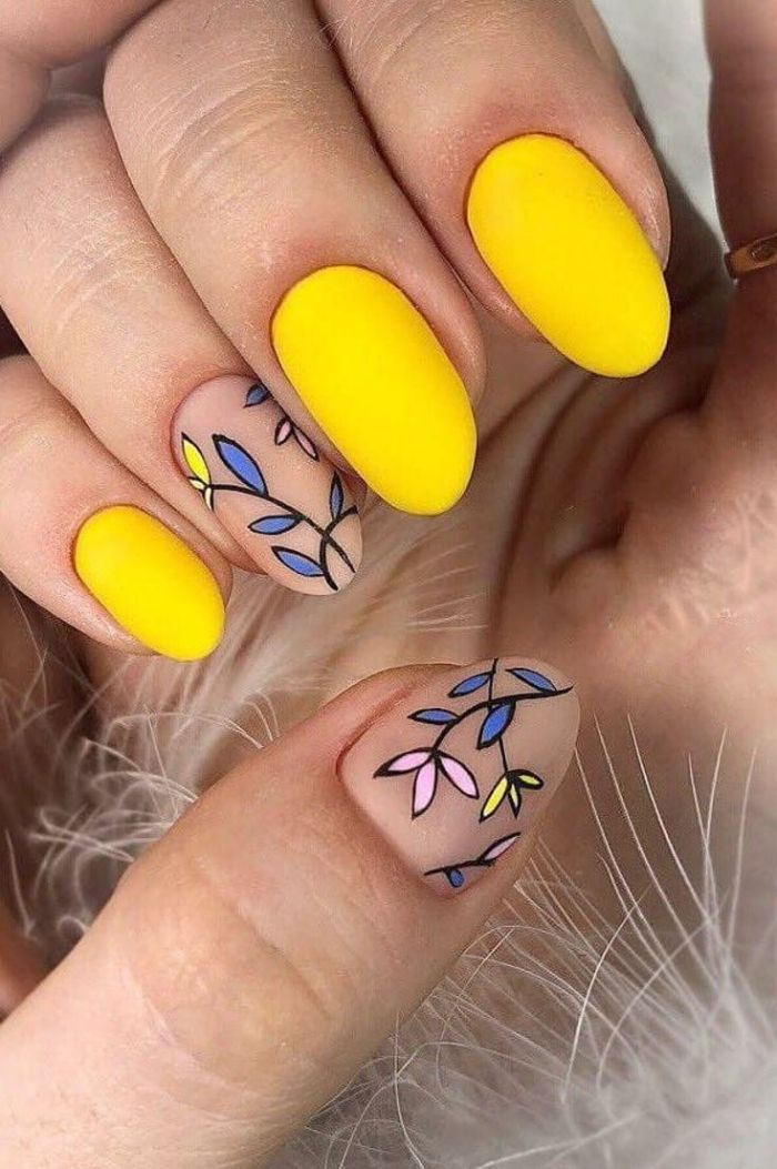 nail designs 2021 yellow and nude nail polish with matte finish floral decorations on ring finger thumb