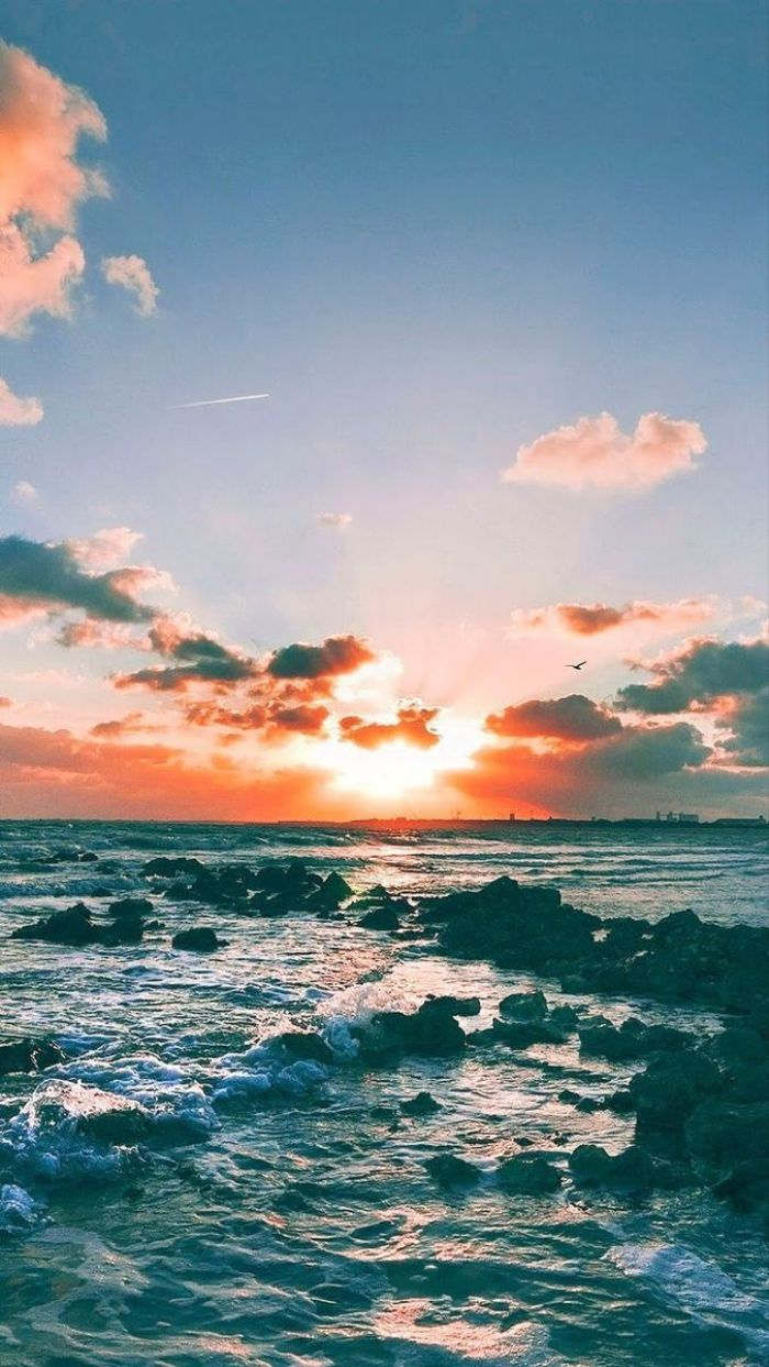 ocean view photographed at sunset cute summer wallpapers waves crashing into small rocks
