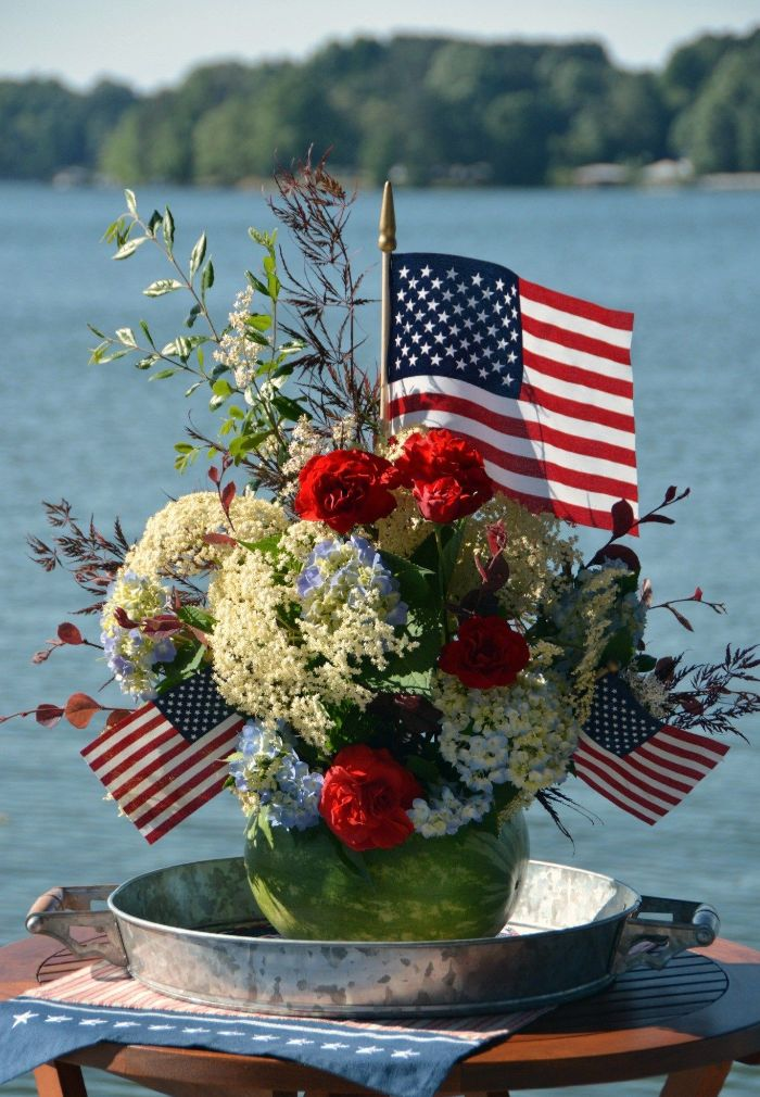 patriotic decorations watermelon planter filled with red white and blue flowers decorated with american flags