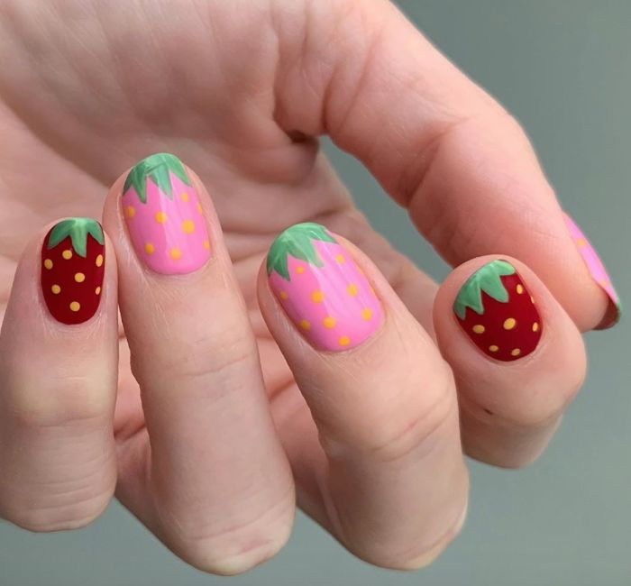 pink and red strawberries drawn on each nail cute acrylic nail ideas short squoval nails