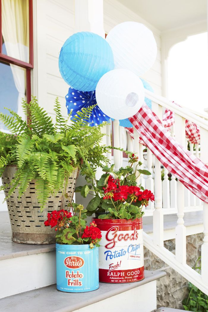 planters in red white and blue with red flowers fourth of july decorations placed on front stairs
