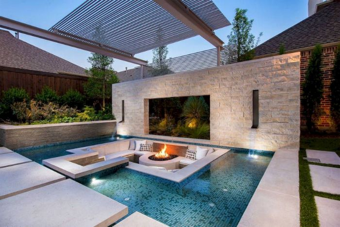 pool with sofa inside how to build a fire pit round concrete fire pit white cushions