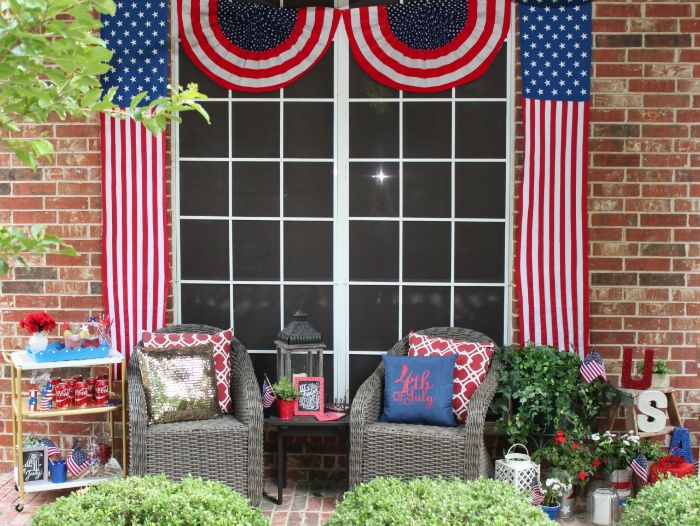 porch with garden furniture 4th of july wreath american flags hanging next to windows