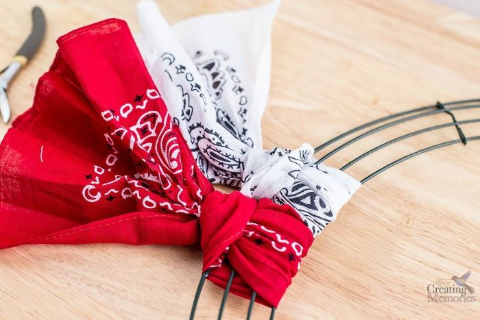 red and white bandana tied to floral wreath fourth of july wreath step by step diy tutorial