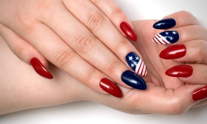 red blue nail polish on long almond nails 4th of july nail ideas american flag decorations on each ring finger