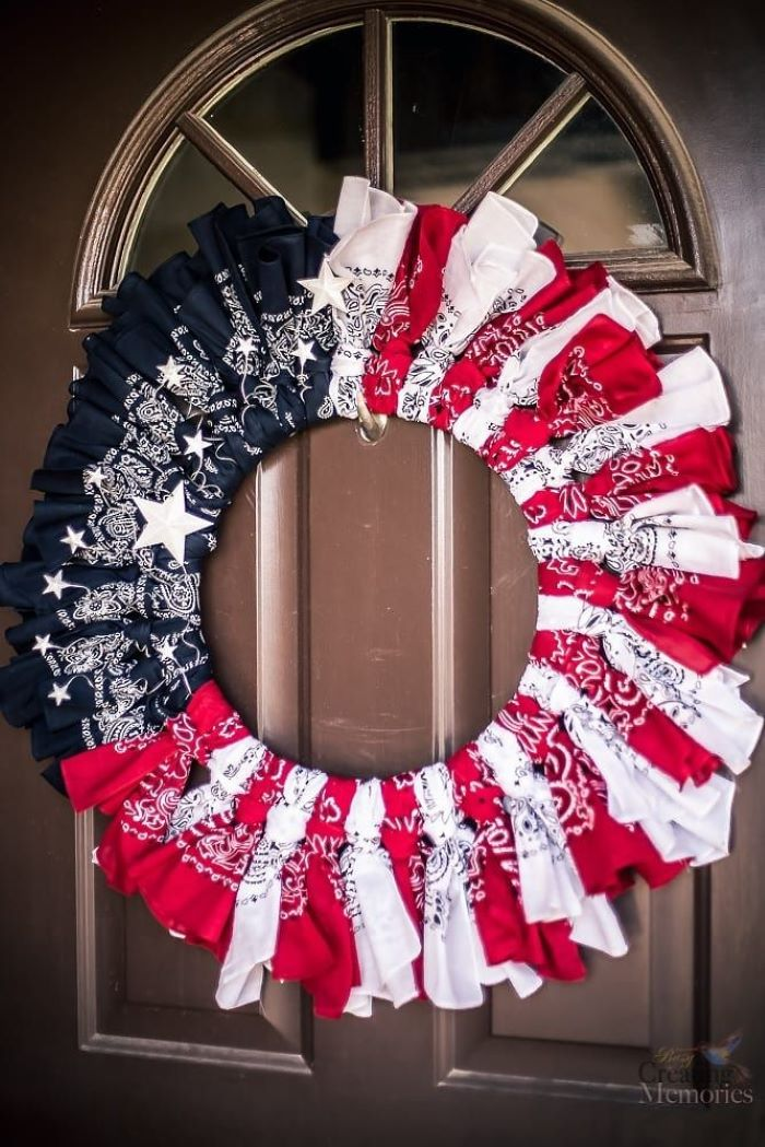 red white and blue wreath made of bandanas fourth of july wreath hanging on wooden door