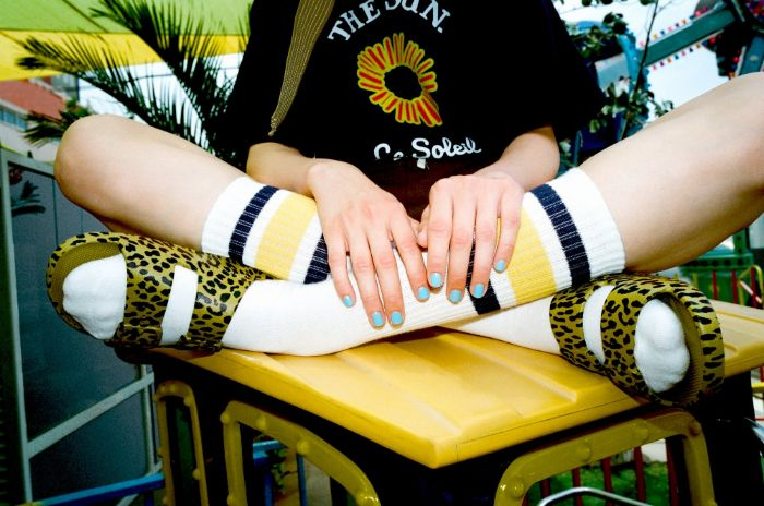 short squoval nails with blue nail polish cute nail designs girl sitting on top of table wearing leopard print sandals