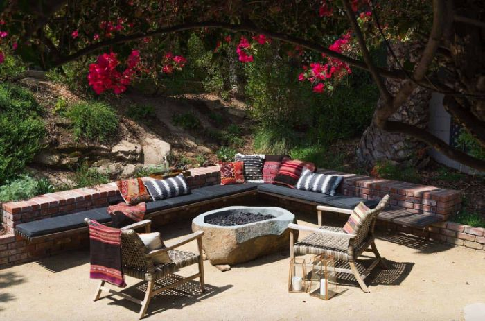 small brick wall bench with colorful throw pillows how to build a fire pit next to round stone fire pit