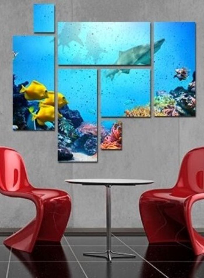 split canvas of underwater photo décor ideas for living room hanging above two red chairs round table