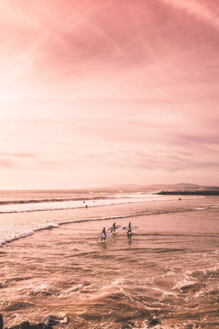 summer wallpaper hd pink aesthetic three surfers getting out of the water at sunset