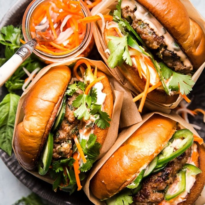 three burgers wrapped in paper garnished with parsley best burger recipe placed in bowl