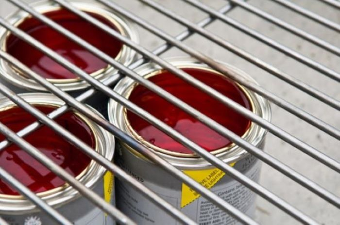 three cans filled with igniting liquid placed under oven rack backyard fire pit ideas landscaping step by step diy tutorial