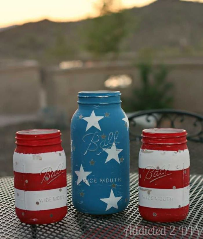 three mason jars painted in red white and blue 4th of july banner stars and stripes