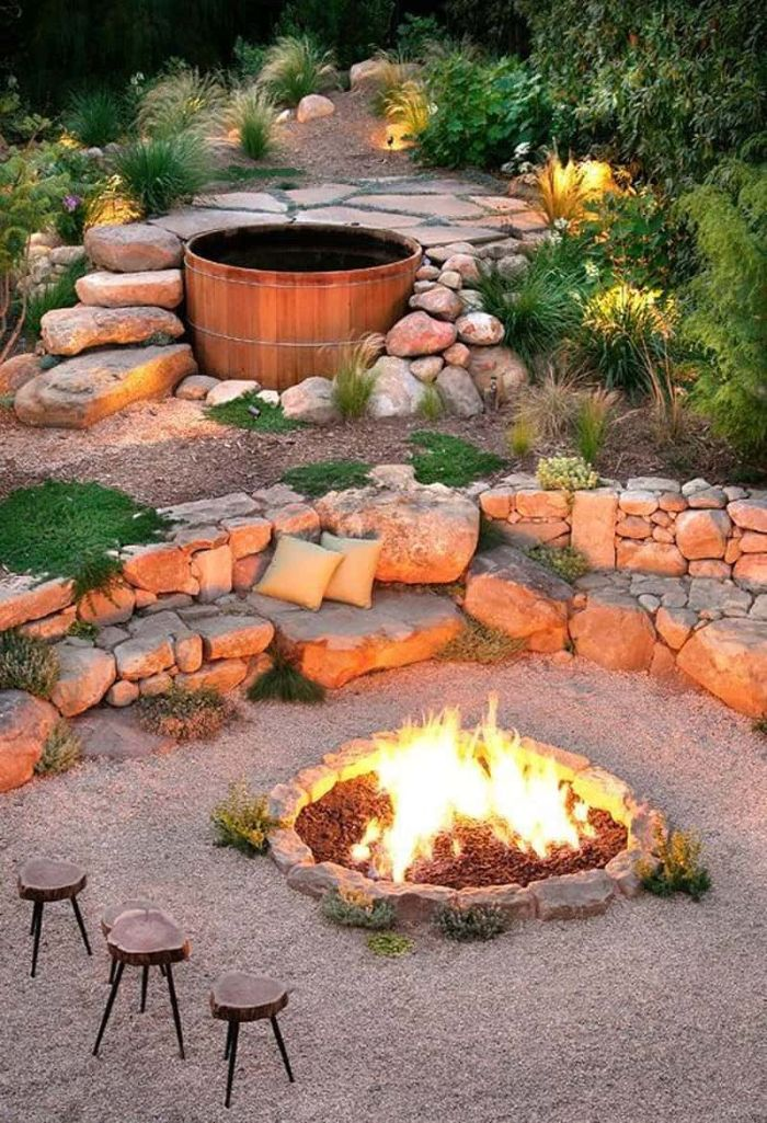 three small wooden stools next to diy fire pit ideas fire burning inside on top of gravel