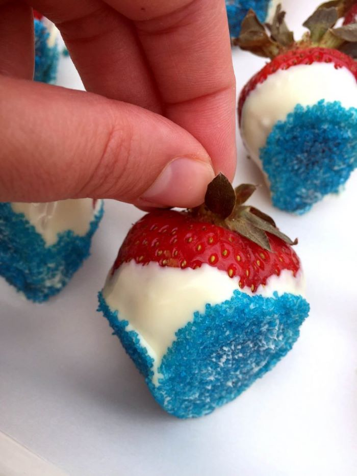 traditional 4th of july foods strawberries dipped in white chocolate decorated with blue sugar