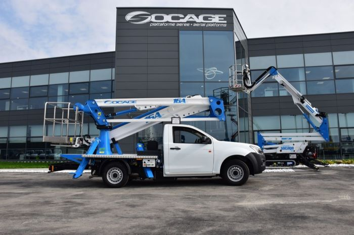 truck mounted articulated work platforms international consolidation strategy parked in front of socage building