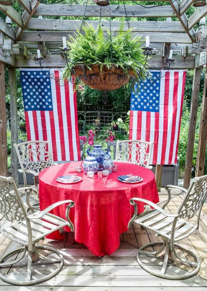 two american flags hanging behind dining table patriotic decorations patio decor
