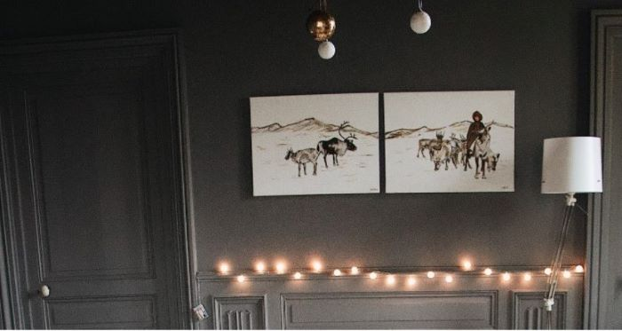 two split photos hanging on black wall decor ideas for living room fairy lights on the wall