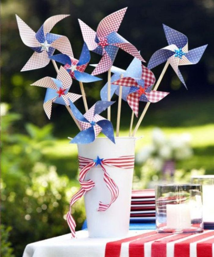 white bucket table centerpiece with paper fans in red white and blue 4th of july wreath