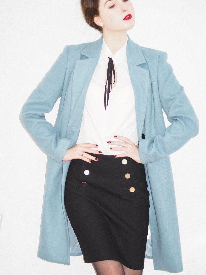 woman wearing black skirt white blouse women fashion for summer 2021 blue pastel coat