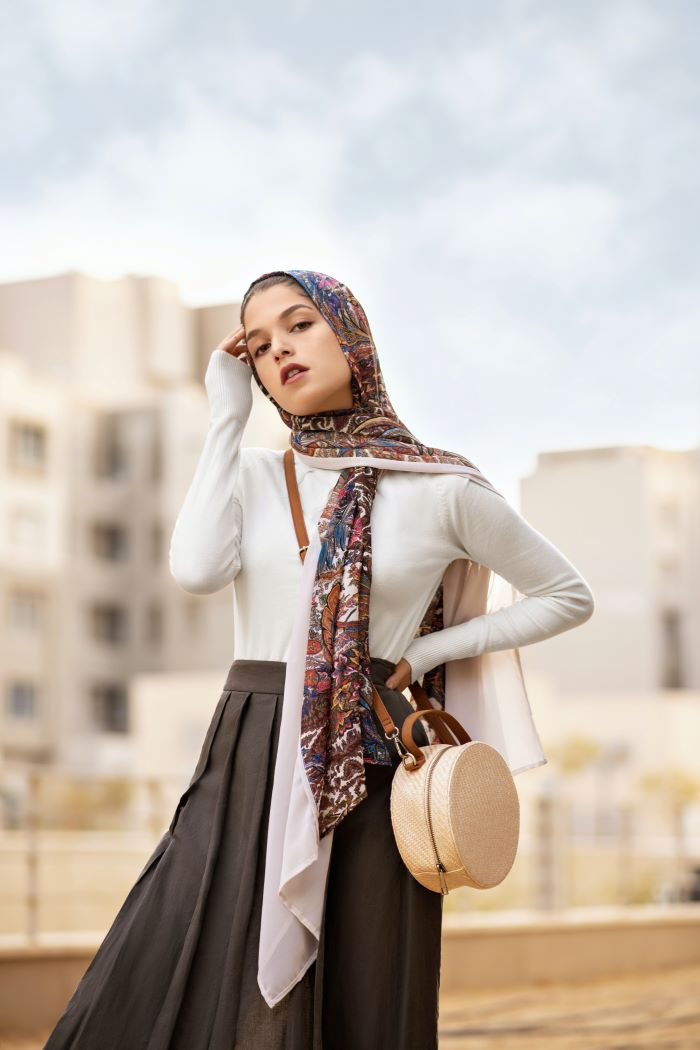 woman wearing colorful head scarf women fashion for summer 2021 black skirt white blouse
