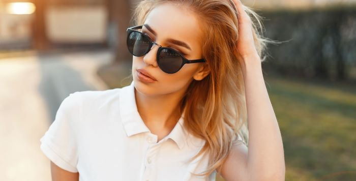 women fashion for summer 2021 woman with blonde hair wearing sunglasses white t shirt