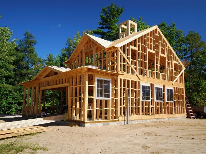 wooden house structure foundation for building your own house tall trees around it