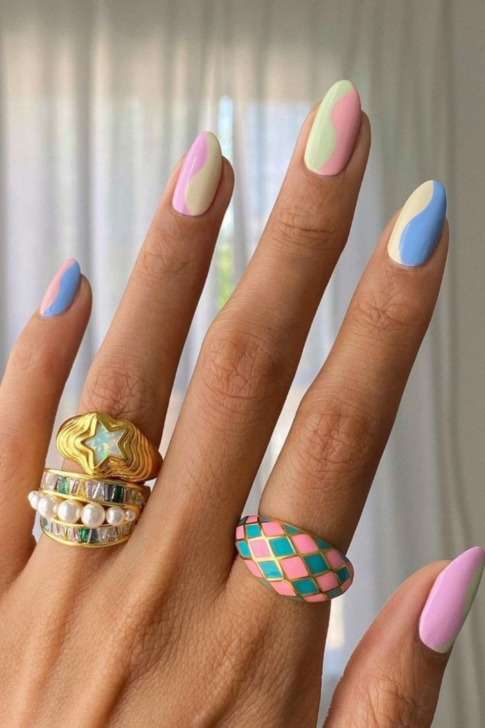 acrylic nail ideas rainbow nails with swirls in pink yellows blue green purple on medium length nails