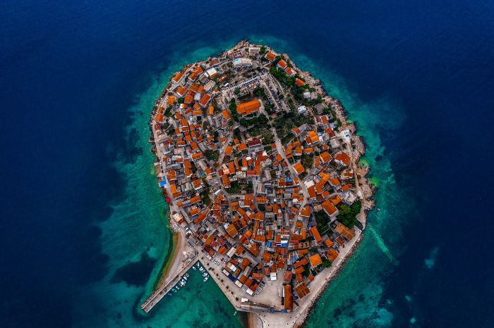 aerial view of hrvoje croatia beach aesthetic lots of houses and buildings on the island surrounded by blue water