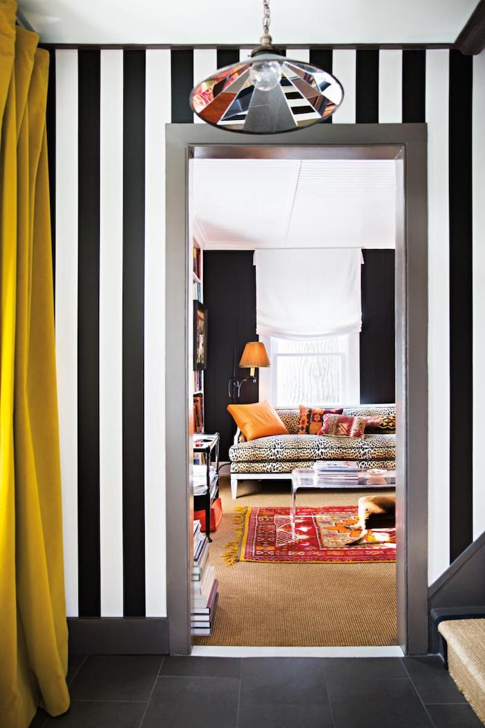 black and white stripes wallpaper on the walls black tiles on the floor narrow hallway ideas colorful light fixture