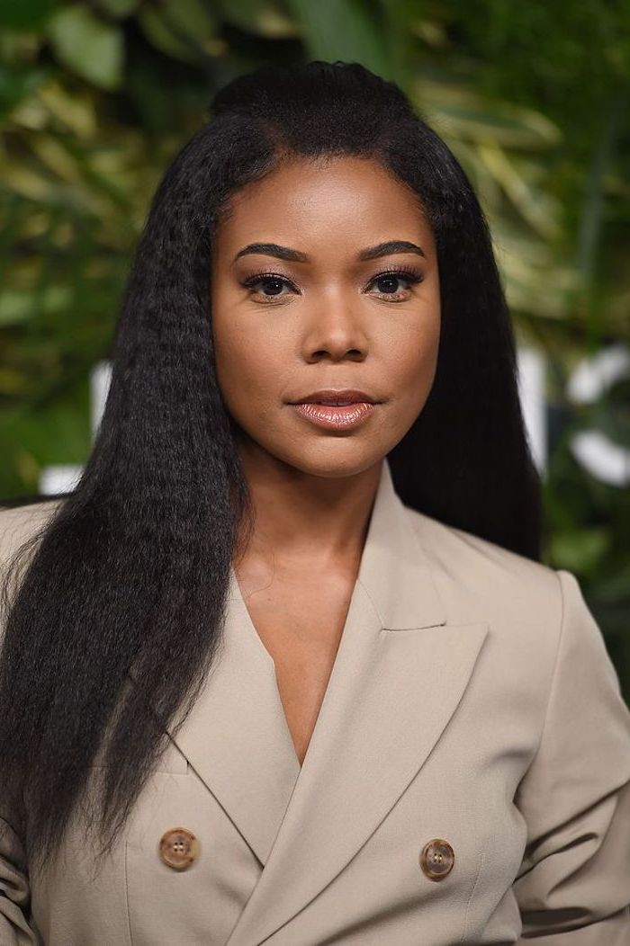 black hair crimped bob gabrielle union photographed on red carpet wearing gray jacket