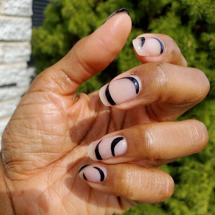 black swirls and lines on nude nail polish nail design ideas medium length nails with minimalistic design
