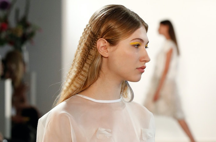 blonde model on the runway how to crimp hair wearing white top yellow eyeliner