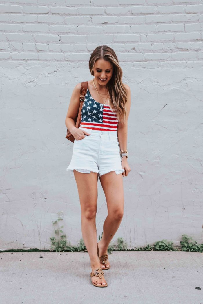 blonde woman wearing white denim shorts baby girl 4th of july outfit american flag top