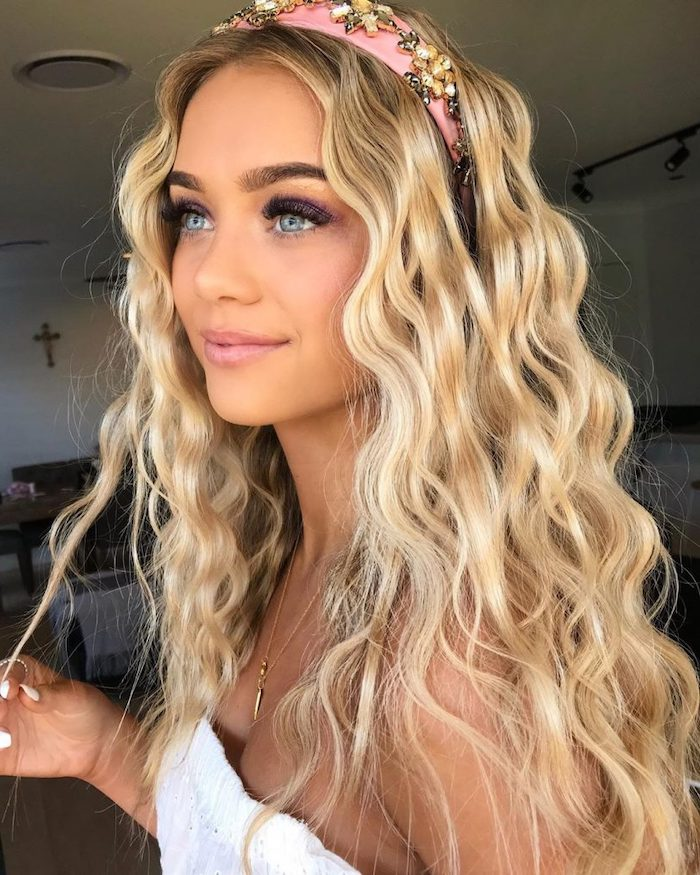 blonde woman wearing white lace top what is crimping with long blonde hair pink head band