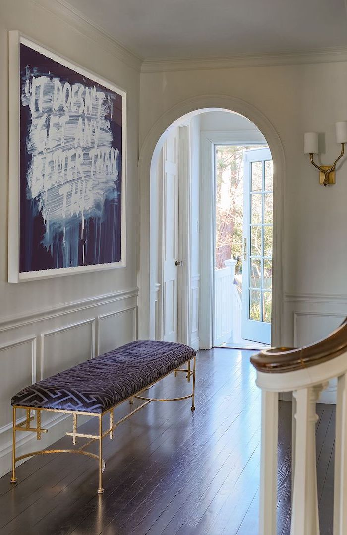 blue leather bench with gold metal frame entryway design ideas blue and white art hanging above it