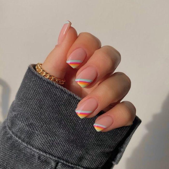 blue orange purple yellow rainbows on the corners of each nail spring nail designs medium length nails