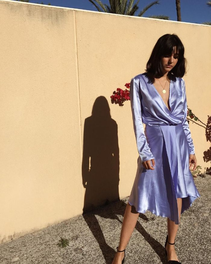 blue satin dress with long sleeves fourth of july outfits worn by woman with shoulder length black hair