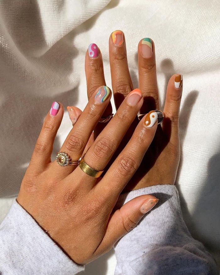 blue yellow purple green orange yellow brown cute short acrylic nails different decorations on each nail with different colors