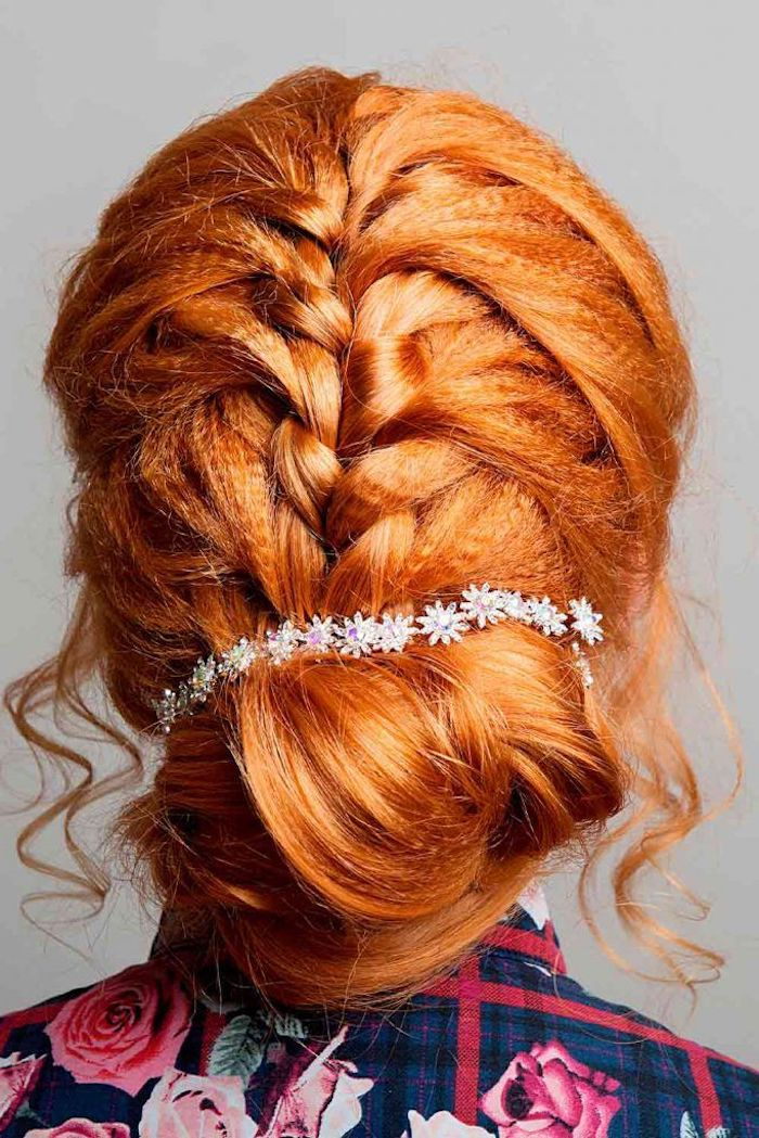 brad with wavy crimped hair tied in low updo decorated with rhinestone flowers