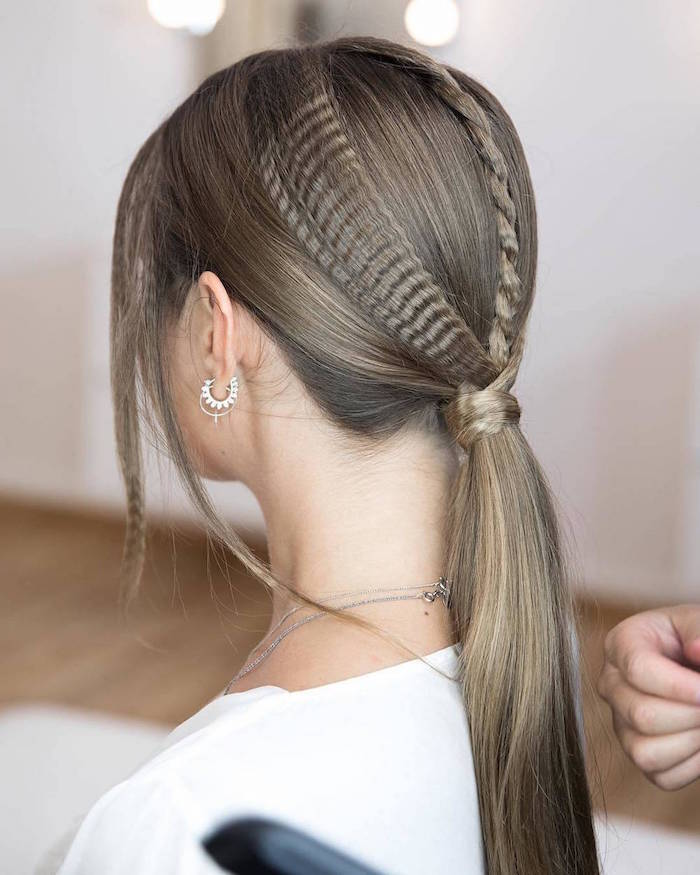 braid and crimped strands of hair tied in low ponytail short crimped hair woman with dark blonde hair