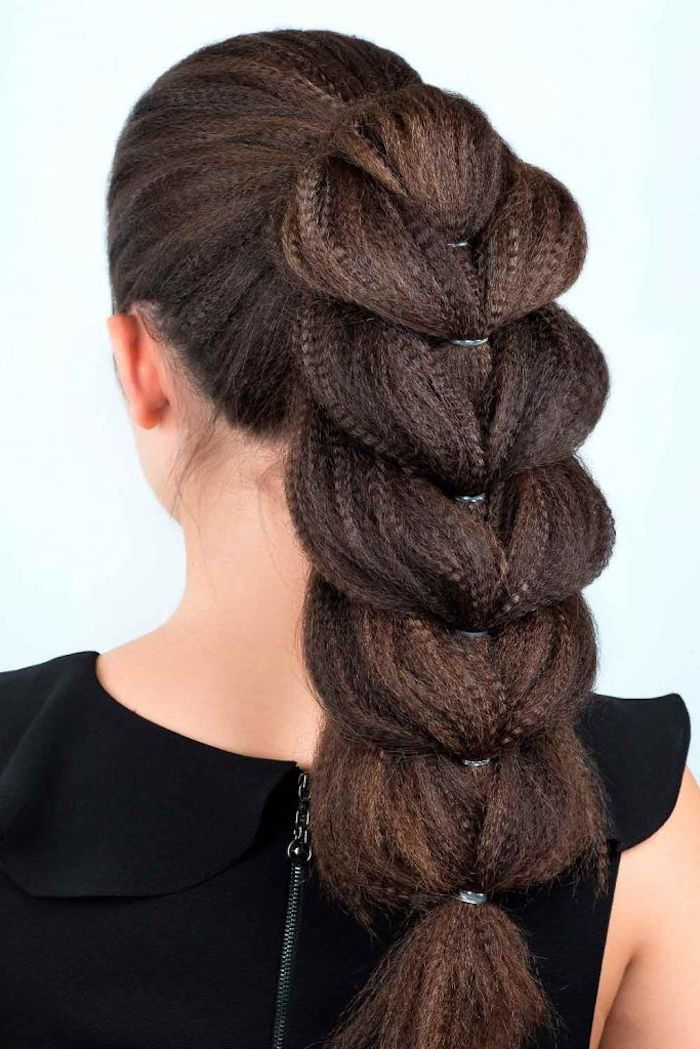 brown hair in high pontail braided in messy braid wavy crimped hair on woman wearing black top