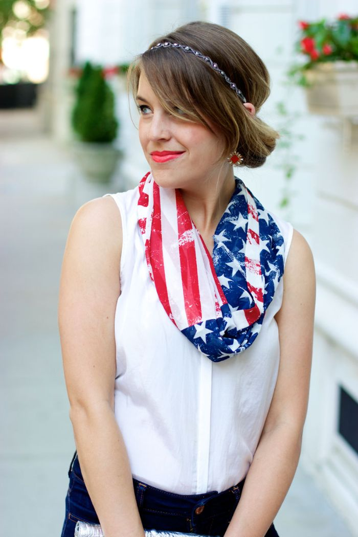 brunette woman wearing jeans white top 4th of july shirts american flag scarf
