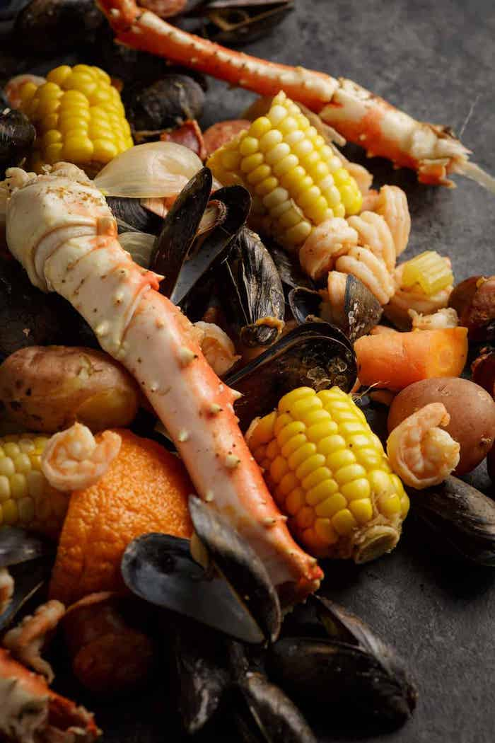 close up photo of seafood boil how long to boil shrimp corn on the cob mussels potatoes carrots