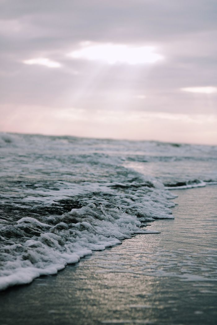 close up photo of waves crashing into the beach beach background hd cloudy sky