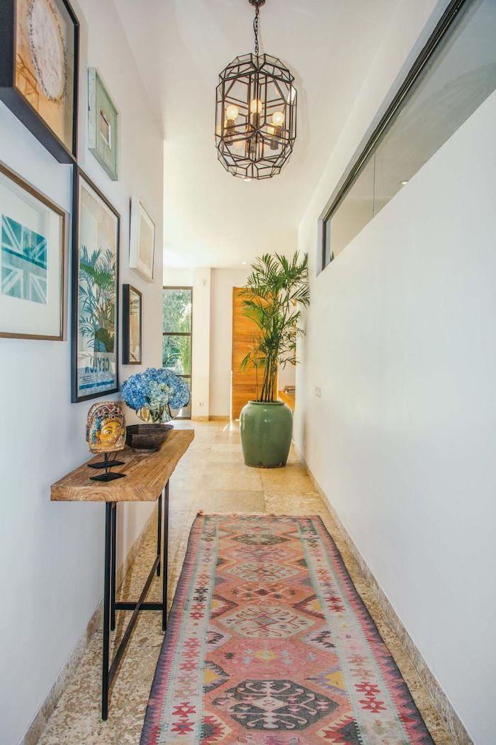 colorful rug on the floor hallway decor ideas wooden bench framed art on the wall